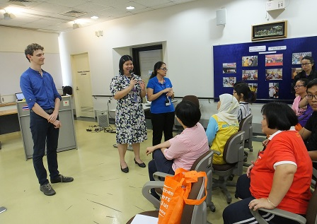 A Thammasat University professor interacting with APCD's Skills Development Training participants with disabilities