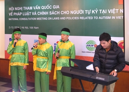 Children with autism performing for meeting participants