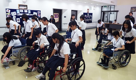 Students learning how to use wheelchairs