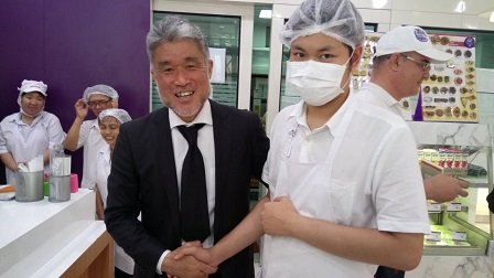 Dr. Toda with a 60 Plus+ Bakery & Cafe trainee with disability