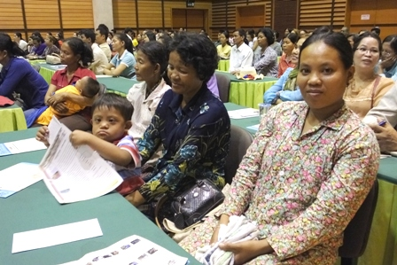A young participant, with his family, at the National Workshop for the Establishment of the Cambodian Intellectual Disability and Autism   Network (CIDAN)