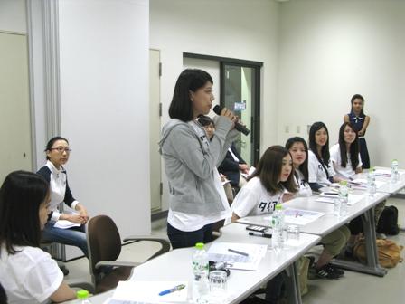 Study Trip participant posing a question