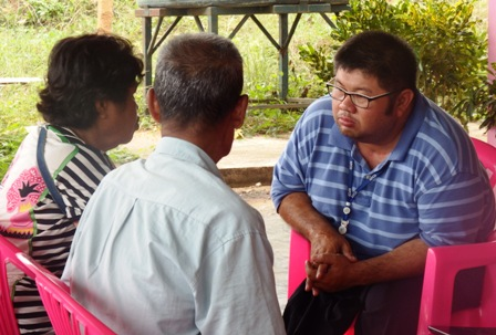 CIAI-APCD Project staff discussing the situation of persons with disabilities in the community