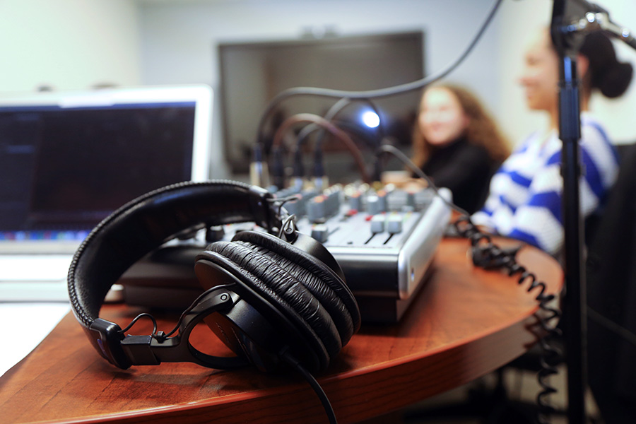 """Headphones and a sound board before a recording for the first edition of the School of Civil and Environmental Engineering's new """"Field Notes"""" podcast. (Photo: Jess Hunt-Ralston)"""