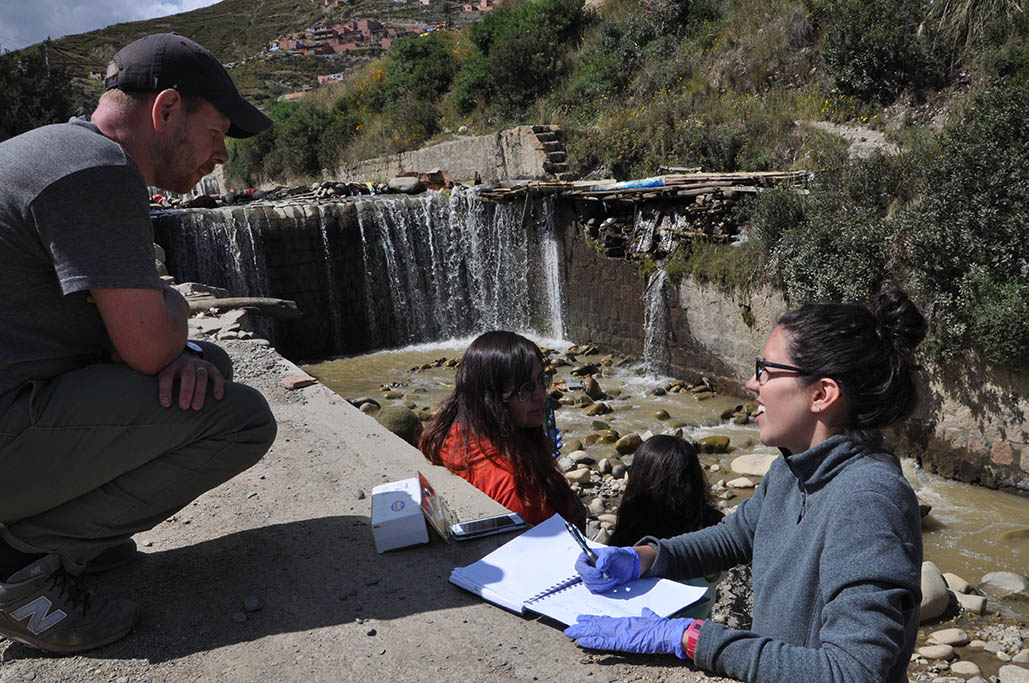 Joe Brown and undergrad Valeria Hernandez discuss some of the field samples the students collected in Bolivia in 2016. The group traveled as part of Brown's Environmental Technology in the Developing World course. Some of the work they did served as pilot data for Brown's newly funded Early Career Development award from the National Science Foundation. (Photo Courtesy: Environmental Technology in the Developing World Class)