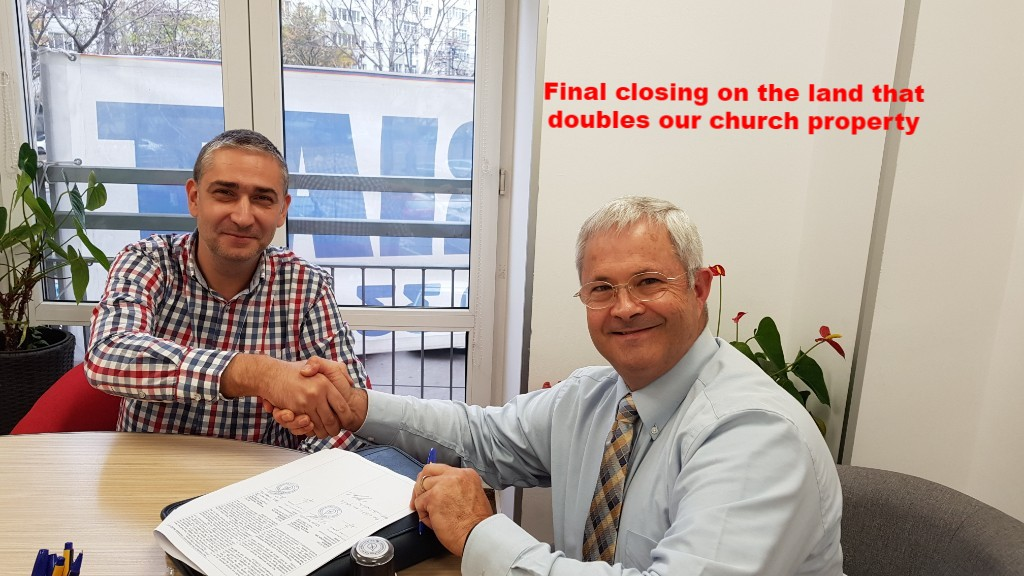 Shaking hands after signing property purchase contract