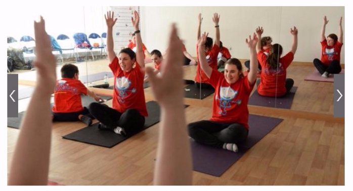 Screenshot of Irish times website with photo of children and teacher in red shirts stretching