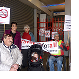 Picture of Transport for All members protesting in front of the lift at Brixton Underground station.