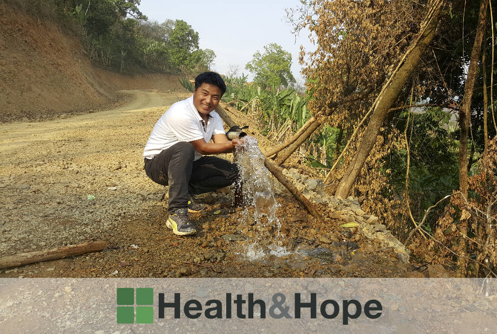 Dr Sasa and running water from the new clean water supply