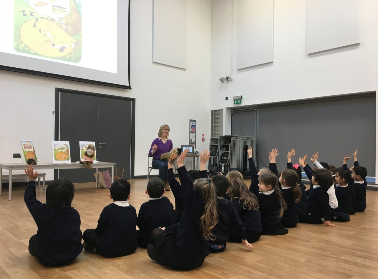 Karen Inglis reading to Reception year pupils