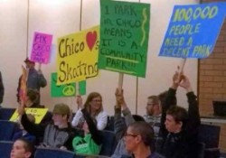 Parents supporting the skatepark with signs