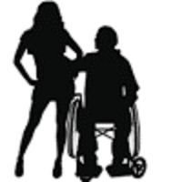 Silhouette of a women standing next to a man sitting in a wheelchair