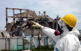 man in hazmat suit at Fukushima Power Plant