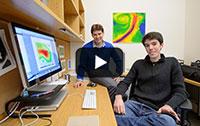 Noah Diffenbaugh and Daniel Swain at desk.