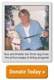Boa and Dreidel, her first dog from the prison puppy training program. Donate today!