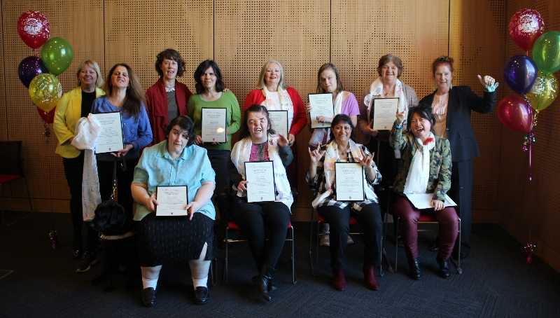 Image of graduation ceremony of Enabling Women, 12 women with disabilities proudly display their graduation certificates