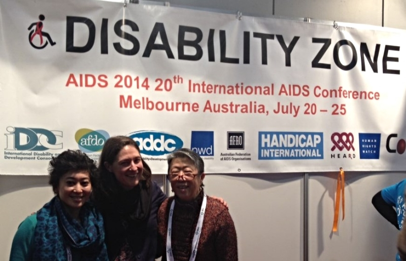 : left to right: Muriel Mac-Seing (HIV and AIDS Advisor, Handicap International), Jen Hargrave (WDV Policy Officer) and Suzanne Lau Gooey (Disability Networking Zone Coordinator and WDV Board Member) meeting at the AIDS Conference Disability Networking Zone