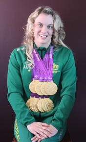 Image of Jacqueline displaying her medals