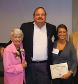 Betty Estes (left) presenting the Betty Estes Scholarship Award to Marieta Bangeova (right)  in 2011.  Bill Kelly, Executive Director of the Illinois Route 66 Scenic Byway (middle) assisted in the presentation.