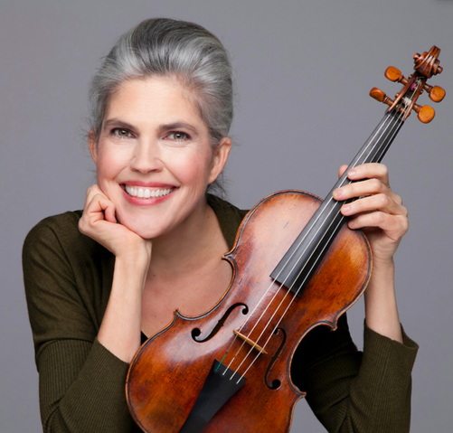 Ingrid Matthews, smiling with her violin