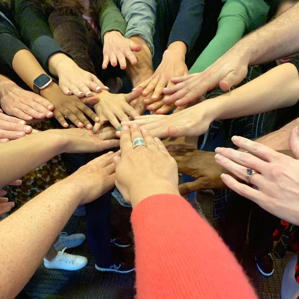 Hands coming together in a circle