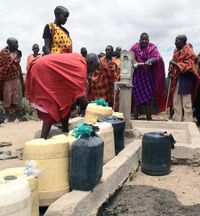 Jamii Moja leaders and local families celebrate the gift of their bore hole water source.
