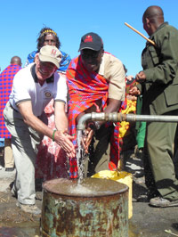 "Rotarians from California and Kenya celebrate the ""Rains from America"" as the community called the gift of water provided by Rotary International"