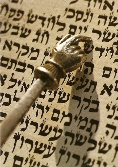 Torah scroll text and pointer