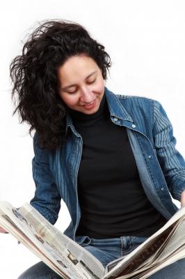Woman reading newsletter