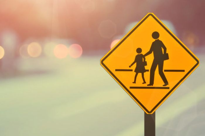 A school crossing sign