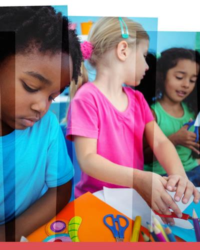 Three young children make arts & crafts