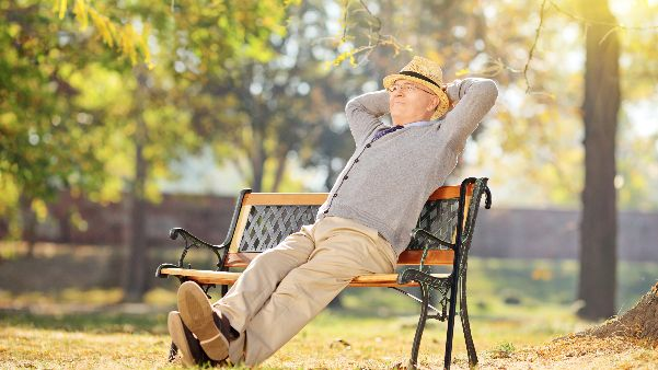 Senior man relaxing on a park bench