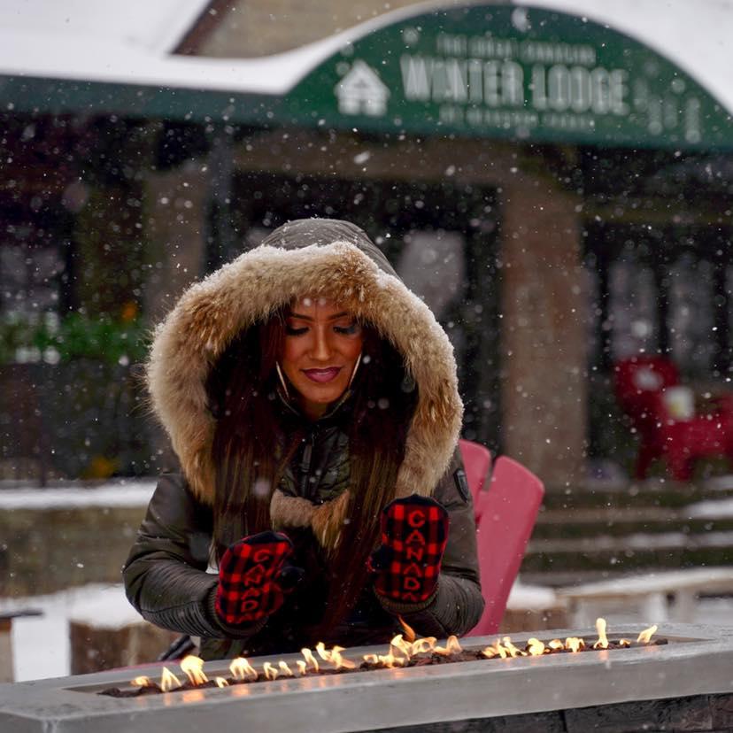 Woman over a bonfire outside
