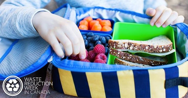 child opening a lunch with reusable containers