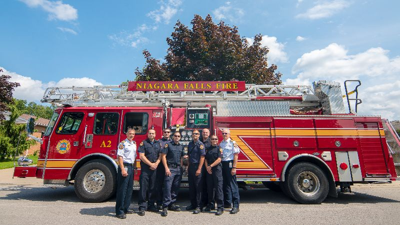 Niagara Falls Fire Department staff - standing outside of a firetruck