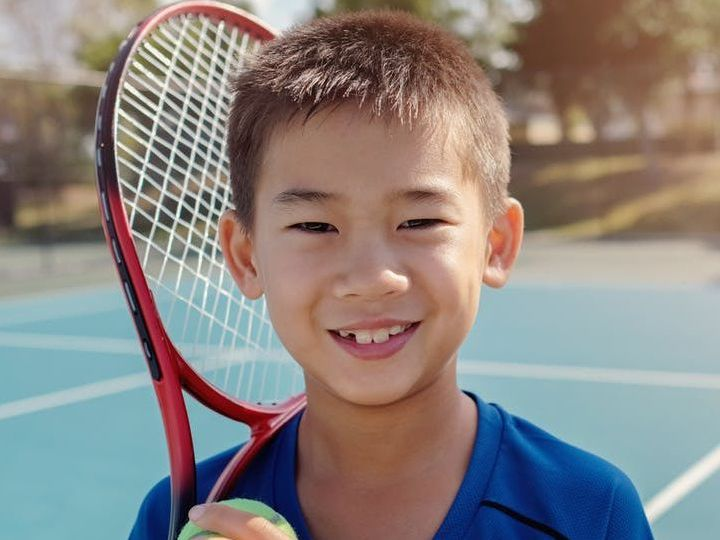 Young boy tennis player