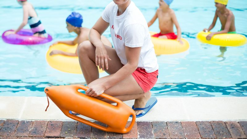 lifeguard in front of a pool