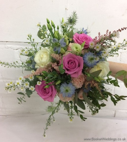 Rustic bridal bouquet in pink, cream and blue with roses, aster daisy, nigella, spray roses, astilbe, lissianthus and eucalyptus