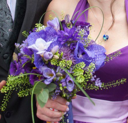 Purple vanda orchid and mixed purple flowers bridesmaid bouquet