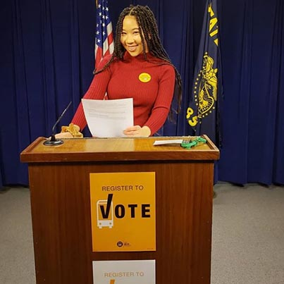Amira Tripp Folsom at a podium.