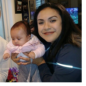 An image of new employee Alma Rios-Rodriguez holding her child.