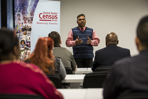 Image of a man presenting during a census training.