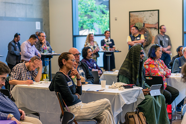 Image of Portlanders engaged in a Code Change presentation during a community event hosted at Mercy Corps in April 2019.