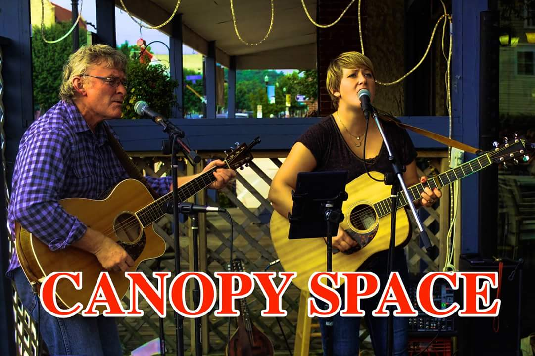 Canopy Space performs on stage.