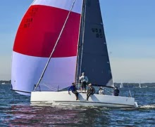J/88 sailing fast under spinnaker