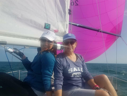 Women J/24 sailors on Lady Minx
