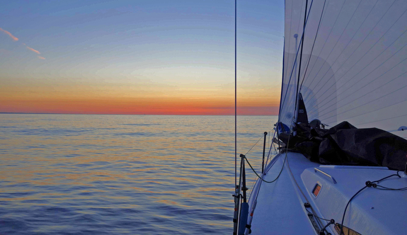 J/121 sailing Block Island Race at sunset