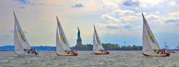 J/24s sailing Lady Liberty Cup regatta off Statue of Liberty