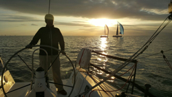 J/111 sailing at sunset