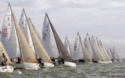 J/80s sailing off start line- La Rochelle, France